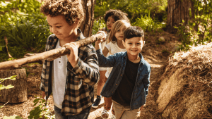 Small group of young kids on a trail.